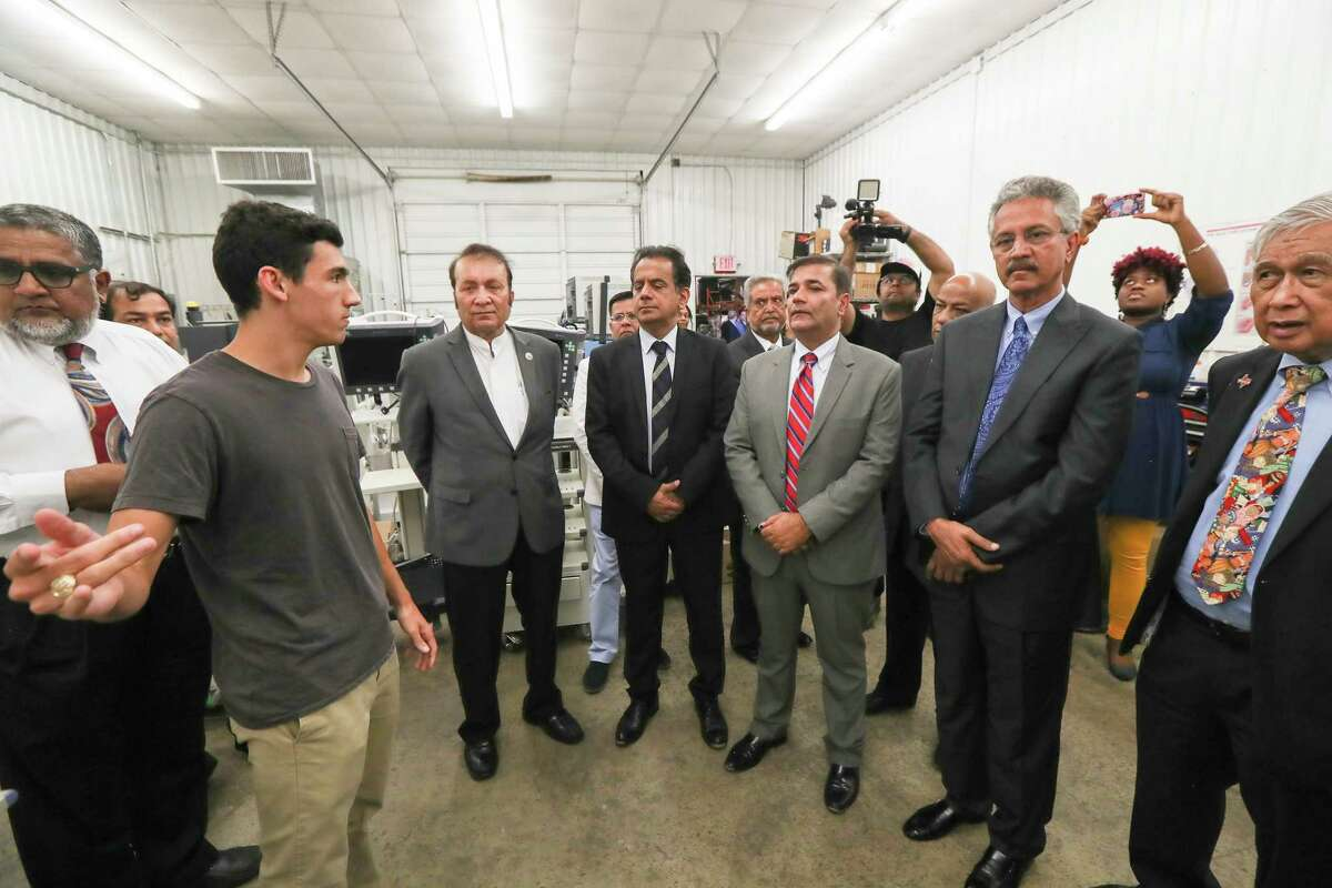 Helping Hands iLyas Choudry, left, and Evan Lowe, second from left, lead a tour of dignitaries, including the Mayor of Karachi, Wasim Aktar, second from right, of the Houston nonprofit Medical Bridges test room Thursday, July 18, 2019, in Houston. Medical Bridges loaded a shipping container with hospital beds and 12 pallets of medical supplies that will be sent to Pakistan.