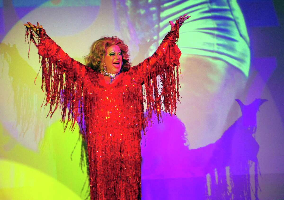 Above, Kenn Hopkins performs as Dolores Dégagé in the SameSex Variety Show & Benefit at the Bijou Theatre in downtown Bridgeport on Thursday during the 9th Annual Bridgeport Pride celebration. The variety show benefits the City Lights Gallery and WPKN radio. At right, Sariah Hassan, of Bridgeport, takes part in the Pride celebration. More photos on A4 and at ctpost.com.