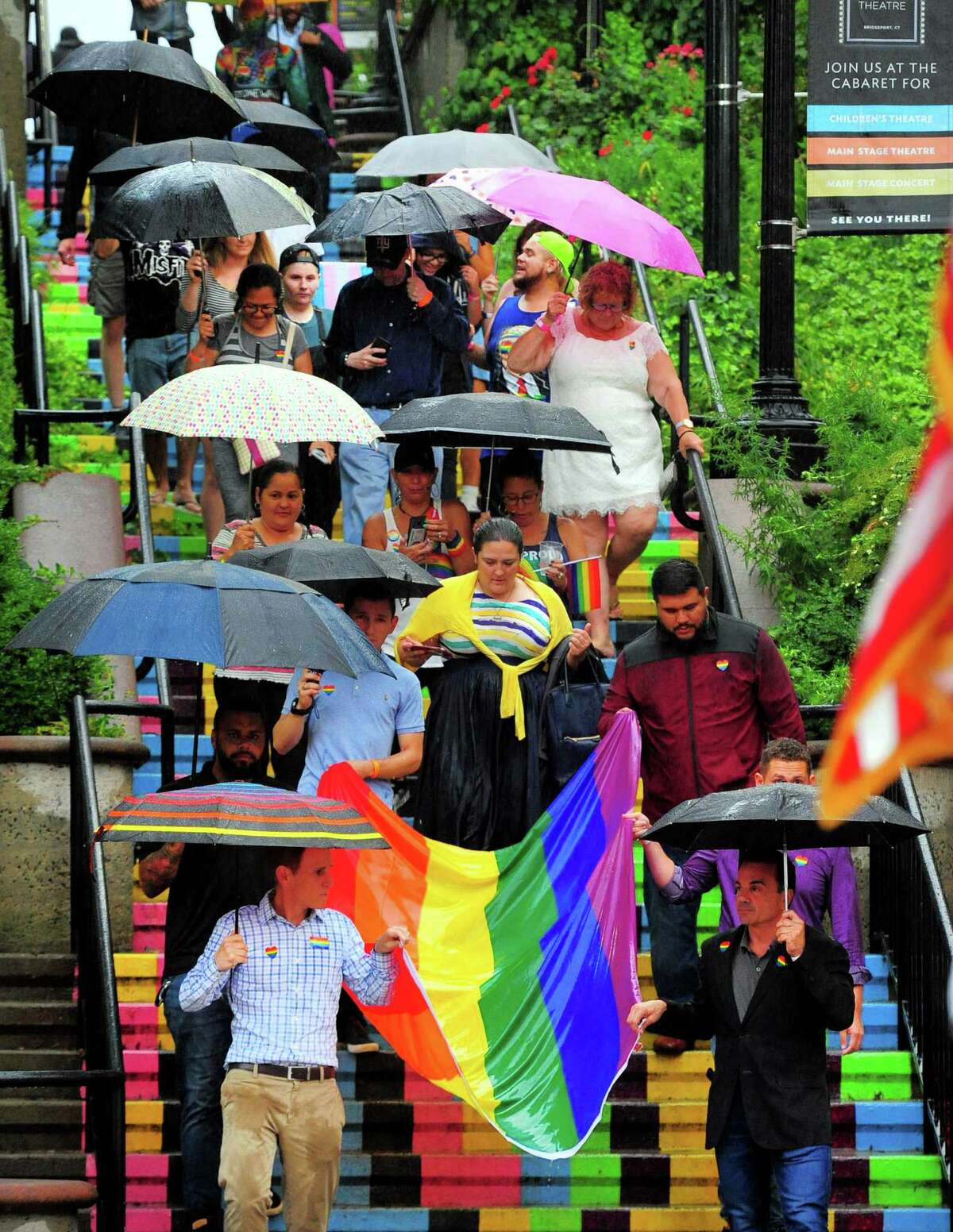 Area residents led by Mayor Joe Ganim, bottom right, take part in the parade down the stairs between Golden Hill Street and Elm Street during the 9th Annual Bridgeport Pride celebration in downtown Bridgeport, Conn., on Thursday July 18, 2019. Everyone made their way to the Bijou Theatre to enjoy the SameSex Variety Show which benefits the City Lights Gallery and WPKN radio.