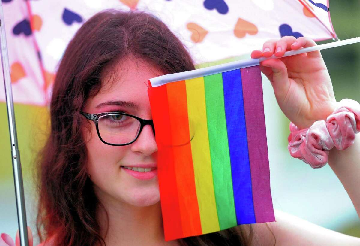 Sariah Hassan, of Bridgeport, takes part in the 9th Annual Bridgeport Pride celebration in downtown Bridgeport, Conn., on Thursday July 18, 2019. After the pride parade participants went to the Bijou Theatre to enjoy the SameSex Variety Show which benefits the City Lights Gallery and WPKN radio.