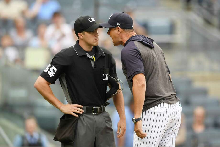 NEW YORK, NEW YORK - JULY 18: Manager Aaron Boone #17 of the New York Yankees argues with home plate umpire Brennan Miller #55 during the second inning of game one of a doubleheader against the Tampa Bay Rays at Yankee Stadium on July 18, 2019 in the Bronx borough of New York City. (Photo by Sarah Stier/Getty Images) Photo: Sarah Stier / 2019 Getty Images
