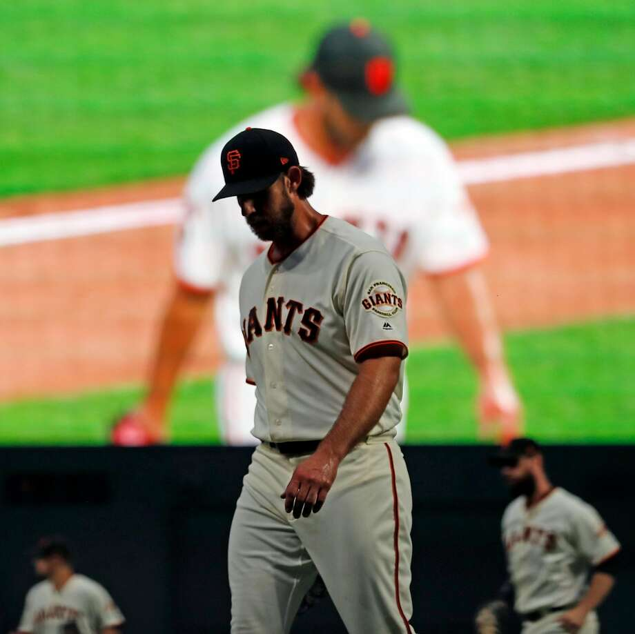 Madison Bumgarner returns to the dugout after retiring the visiting Mets in 6th inning July 18. Photo: Scott Strazzante / The Chronicle