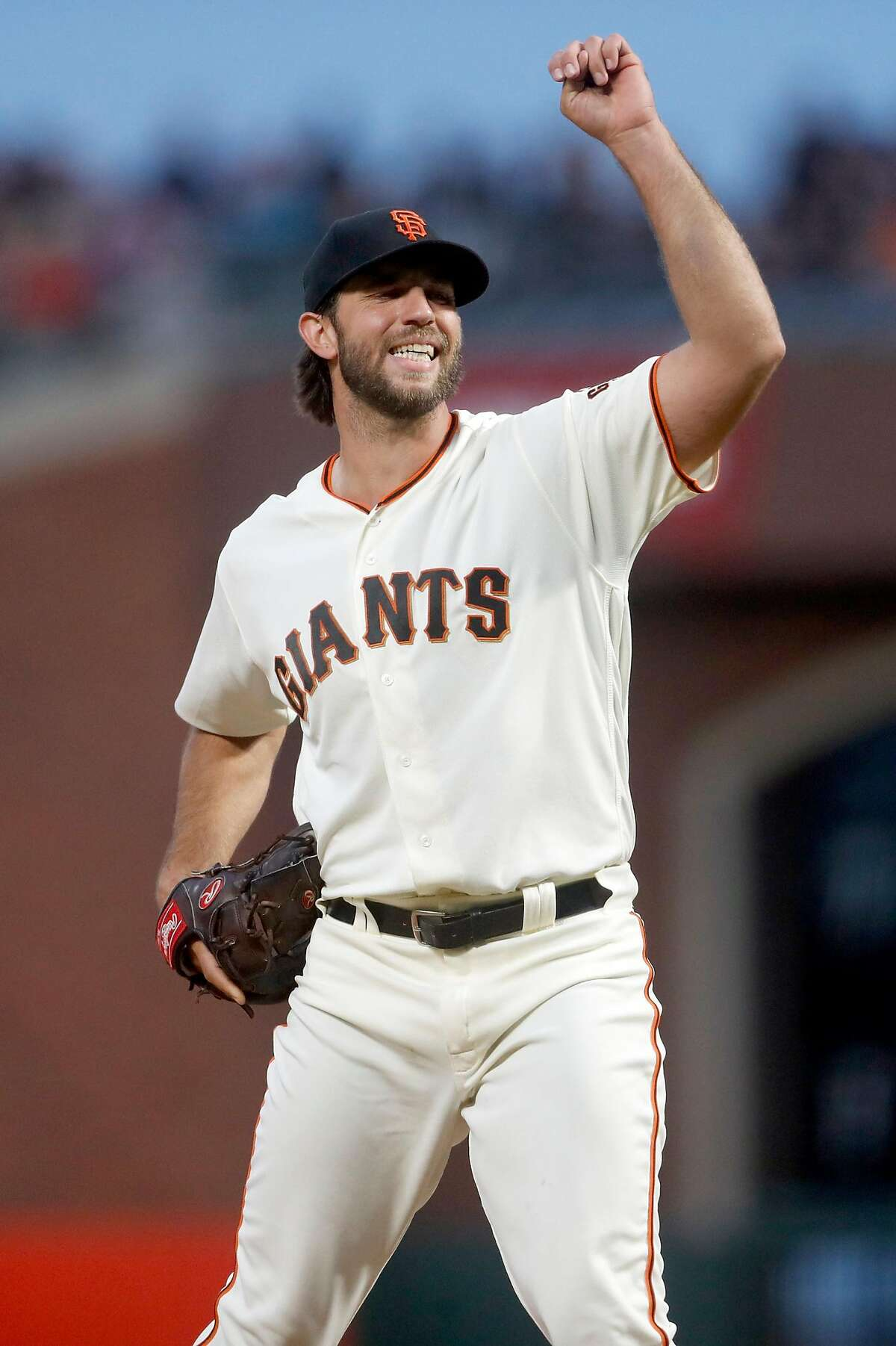 San Francisco Giants' Madison Bumgarner grimaces after throwing a pitch in 6th inning against New York Mets during MLB game at Oracle Park in San Francisco, Calif., on Thursday, July 18, 2019.