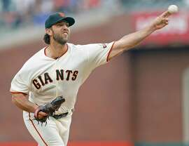 San Francisco Giants' Madison Bumgarner pitches against New York Mets in 1st inning of MLB game at Oracle Park in San Francisco, Calif., on Thursday, July 18, 2019.