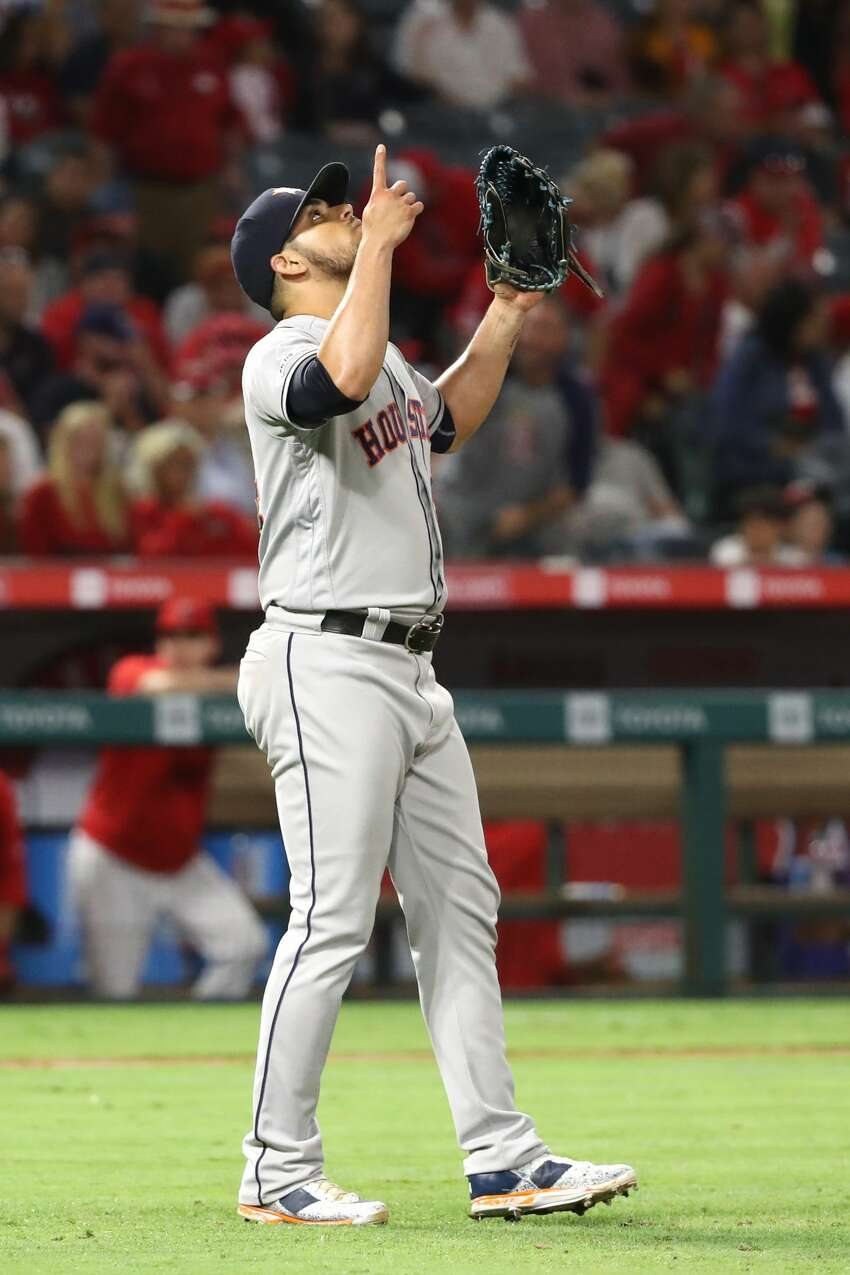ANAHEIM, CALIFORNIA - JULY 18: Roberto Osuna #54 of the Houston Astros reacts after defeating the Los Angeles Angels of Anaheim 6-2 in a game at Angel Stadium of Anaheim on July 18, 2019 in Anaheim, California. (Photo by Sean M. Haffey/Getty Images)