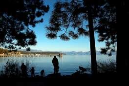 Along the shore of Lake Tahoe under clear blues skies on Fri. November 16, 2018, in Tahoe City, Ca.