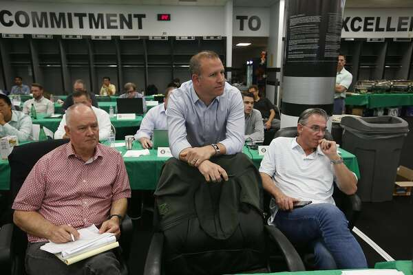 OAKLAND, CA - JUNE 3: Adviser Sandy Alderson, General Manager David Forst and Executive Vice President of Baseball Operations Billy Beane of the Oakland Athletics was the MLB Draft in the Athletics draft room, during the opening day of the 2019 MLB draft,