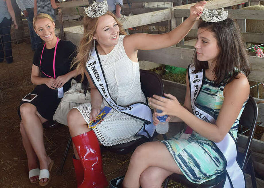 Miss Pike County 2019 Ashley Miller (center) adjusts Junior Miss Pike County Alyvia Groom's crown as pageant director Juliana Frey (left) looks on. Photo: Marco Cartolano | Journal-Courier