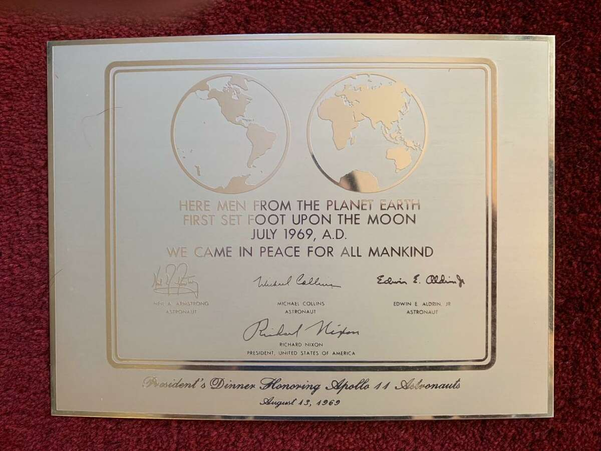 This replica plaque, similar to the one that was left on the moon's surface, is one of Eddie Ostrowski's prized possessions at his Shelton home.