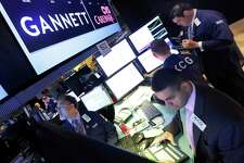 A Gannett logo posted in 2014 on the floor of the New York Stock Exchange. The Wall Street Journal reported on July 18 that Gannett is considering a merger with Gatehouse Media in a deal that would pair the two largest newspaper publishers in the nation. (AP Photo/Richard Drew, File)