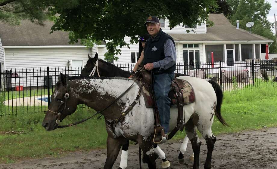 """There are things you can count on during the Saratoga racing season. Hand melons. Pop-up showers. First-class racing. And, of course, D. Wayne Lukas. The Hall of Fame trainer, approaching his 84th birthday, has the energy of men half his age. Here he is on Thursday morning, like he is every morning, on horseback, heading to the track. """"I feel the best when I'm on a horse,"""" D. Wayne said. Not gonna argue with that. (Tim Wilkin / Times Union)"""