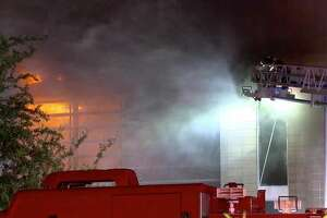 Houston firefighters battle a massive two-alarm house fire in River Oaks on Thursday, July 18, 2019.