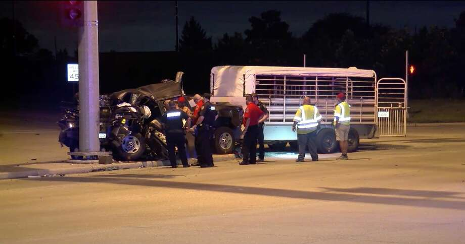 Harris County Sheriff's Office deputies investigate a crash where three horses died while being hauled in a farm trailer Thursday, July 18, 2019. Photo: OnSceneTV