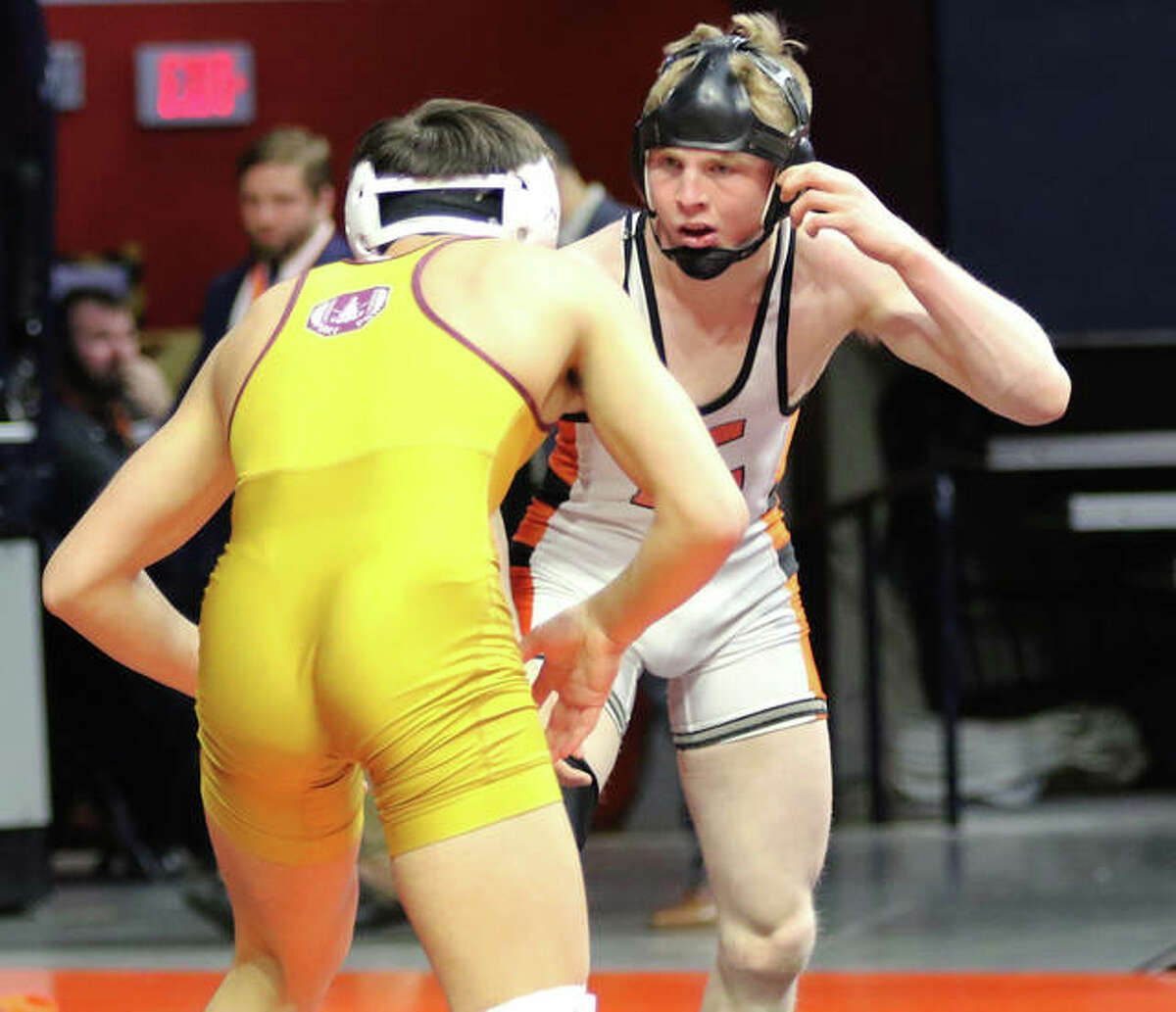 Edwardsville's Noah Surtin (right) and Lockport's Matt Ramos wrestle in the Class 3A state championship match at 120 pounds in February at State Farm Center in Champaign.
