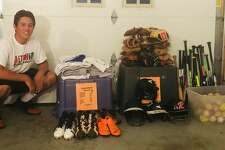 Ridgefield High School senior Will Carbonari with the baseball equipment he collected this summer.