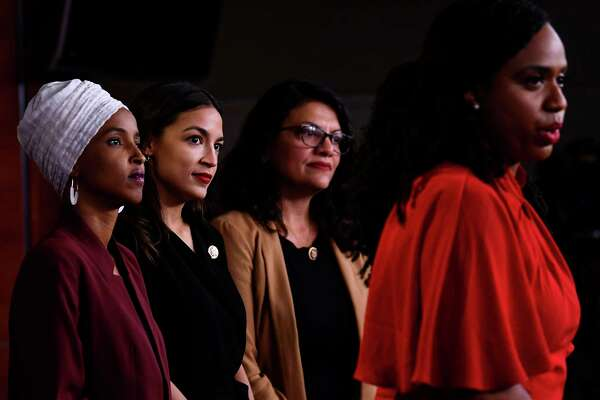 U.S. Rep. Ayanna Pressley, D-Mass., speaks as, from left, Representatives Ilhan Abdullahi Omar, D-Minn., Alexandria Ocasio-Cortez, D-N.Y., and Rashida Tlaib, D-Mich., hold a news conference on July 15, 2019, to address remarks made by President Donald Trump earlier in the day, at the Capitol in Washington, D.C.