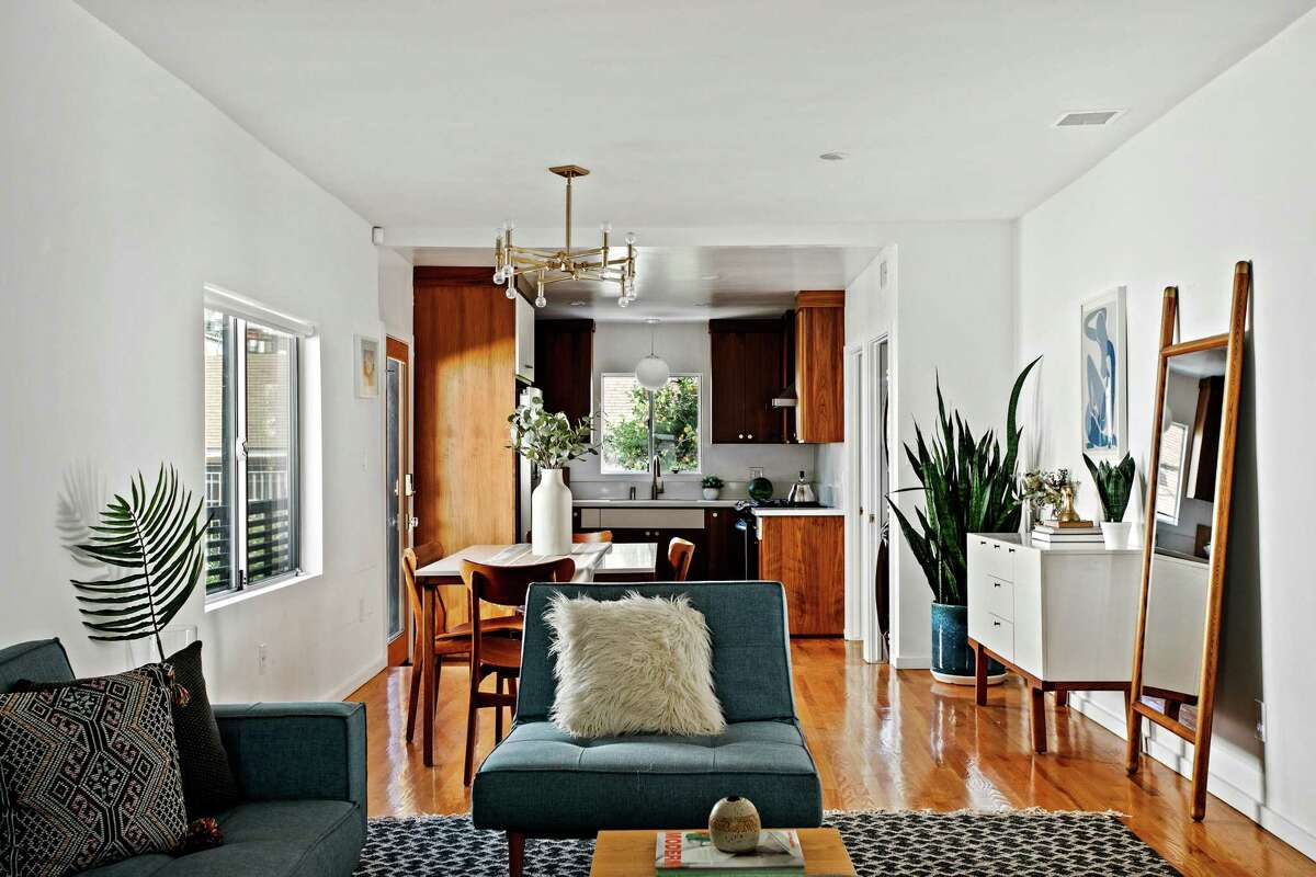 The Los Feliz home of record producer Derek Davies has been updated with a mix of eye-catching fixtures and details. Among the,: walnut cabinetry and artistic tilework. Listed for $1.05 million, the 1920s bungalow features a patio, a hot tub and a turf lawn. The detached garage has been converted into a soundproof music studio. (Virtually Here Studios/TNS)