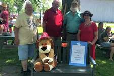 Pictured with the bench are, from left, George Lawson, Sanilac County Historical Society board member; John Kriete, Port Sanilac Lions Club member; David Blaine, Sanilac County Historical Society Board president; and Cathy O'connell-Stewart, Port Sanilac Lions Club President. (Submitted Photo)