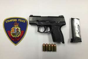 The loaded Taurus .45 caliber semiautomatic handgun that police say they found inside a fanny pack belonging to Elvis Almengot-Castillo on Richmond Hill Avenue in Stamford on Thursday night, July 18, 2019.