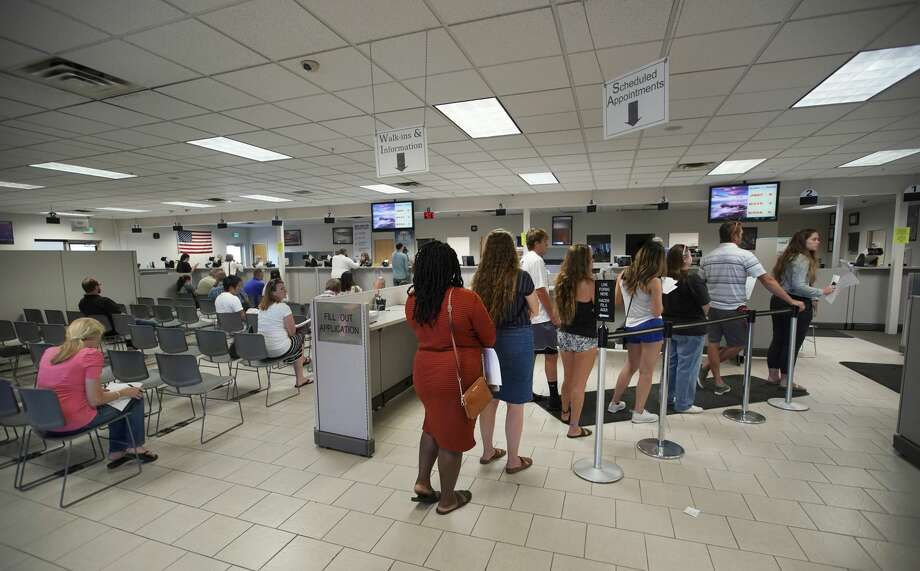 FILE — People wait in line at the Driver License Division for the state of Utah on July 9 in Orem, Utah. Photo: George Frey/Getty Images