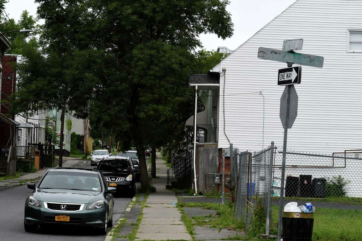 Exterior of the home at 77 Third Avenue, right, where a 3-year-old boy was shot in the arm with a stray bullet fired during a shootout on Friday, July 19, 2019, in Albany, N.Y. (Will Waldron/Times Union)