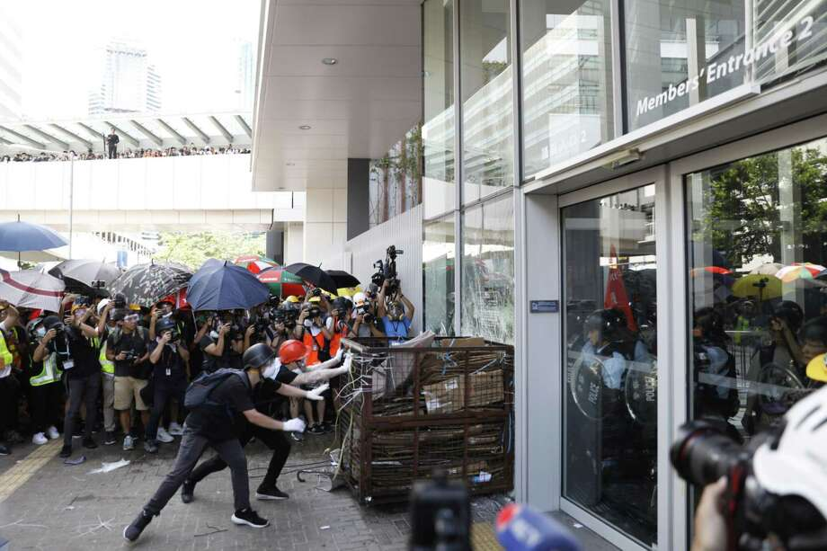 Demonstrators break into the Legislative Council building during a protest on July 1, 2019. Photo: Bloomberg Photo By Justin Chin / Bloomberg