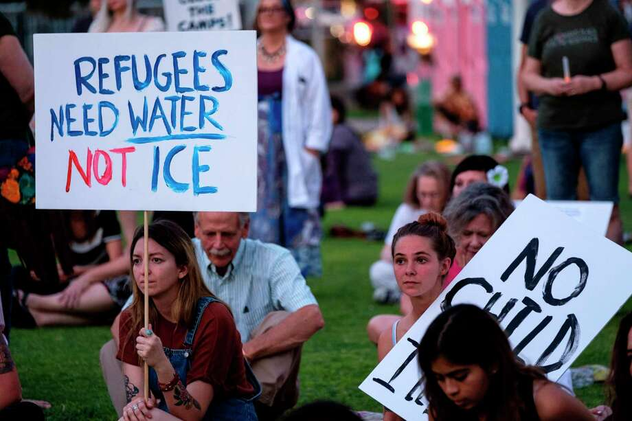 """People gather to protest the treatment of immigrants in detention centers during the """"Lights for Liberty: A Vigil to End Human Concentration Camps"""" event in El Paso, Texas, on July 12, 2019. Photo: Luke Montavon / Getty Images / AFP or licensors"""