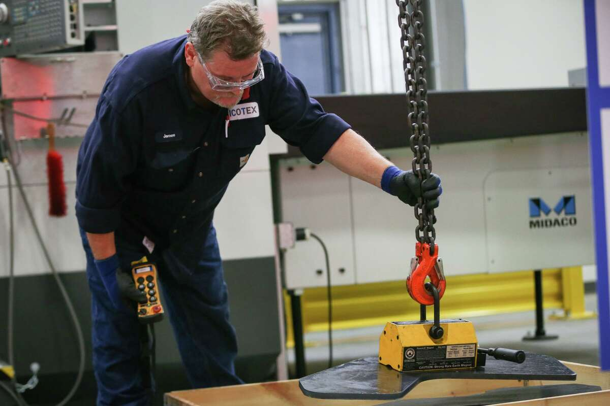 An ICOTEX employee works machinery at a plant in Conroe. The state added 45,000 jobs in June and the unemployment rate fell to a historic low.