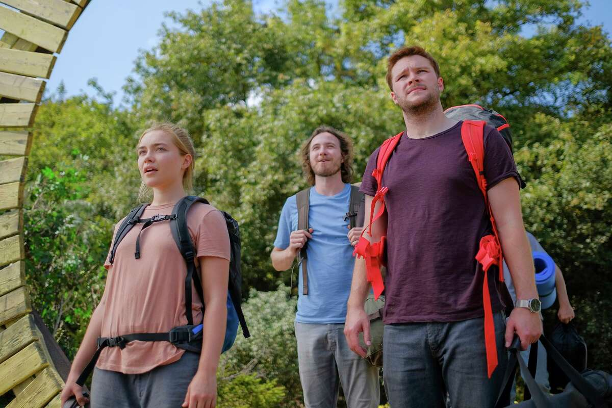 This image released by A24 shows Jack Reynor, right, and Florence Pugh in a scene from the horror film