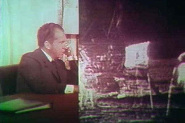 """President Nixon appeared on a split screen, telling the astronauts """"This certainly has to be """"the most historic phone call ever made from the White House."""""""