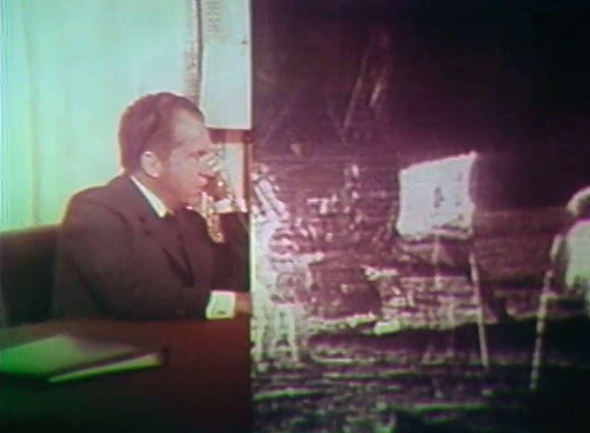 """President Nixon appeared on a split screen, telling the astronauts """"This certainly has to be """"the most historic phone call ever made from the White House."""" >>PHOTOS: What Houston looked when they landed on the moon"""