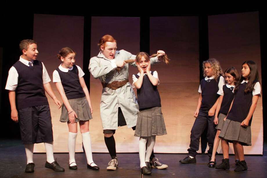 "Jake Sperling, left, Cooper Toland, Dante DiFederico (Miss Trunchbull), Sophia Sibilia (Amanda Thripp), Samantha Sperling, Elena Cappella and Beverlyn Lopez rehearse for Curtain Call's Summer Youth Theatre production of Matilda The Musical"" in The Kweskin Theatre Photo: Curtain Call / Contributed Photo"