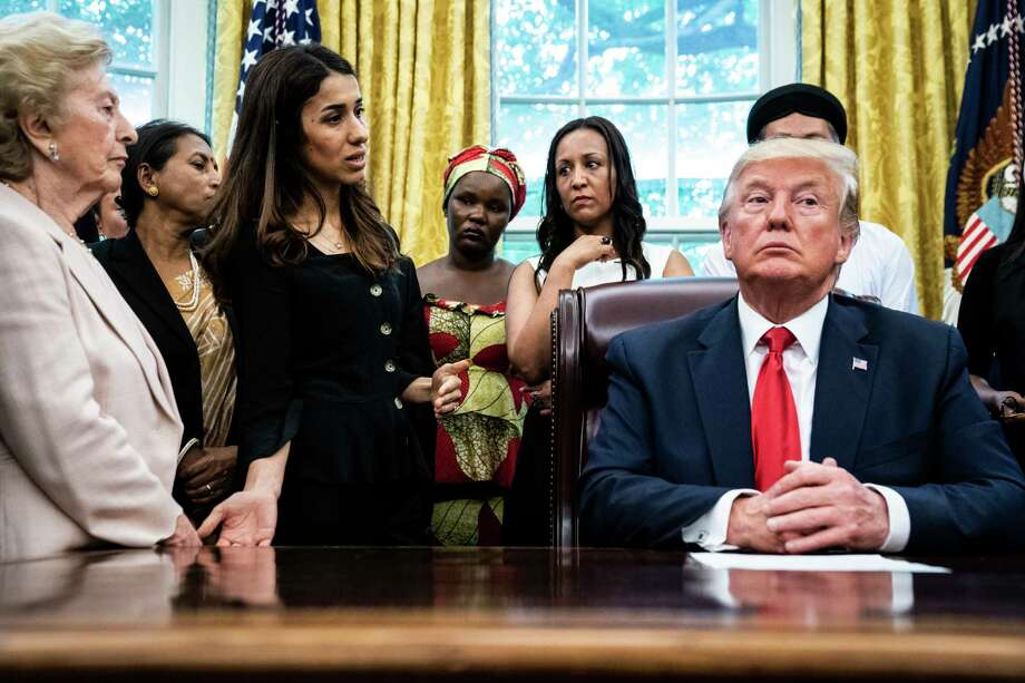 President Trump speaks with Nobel Peace Prize winner Nadia Murad of Iraq during a White House meeting with victims of religious persecution on July 17, 2019. Photo: Washington Post Photo By Jabin Botsford / The Washington Post