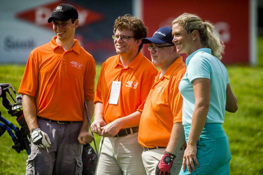 Suzann Pettersen of the LPGA, right, poses for a photo with, from left, Justin Doran, Nick Wagenmaker and Nick McCabe as they compete in the Special Olympics 3-Hole Challenge on Friday, July 19, 2019 at Midland Country Club. (Katy Kildee/kkildee@mdn.net) Photo: (Katy Kildee/kkildee@mdn.net)