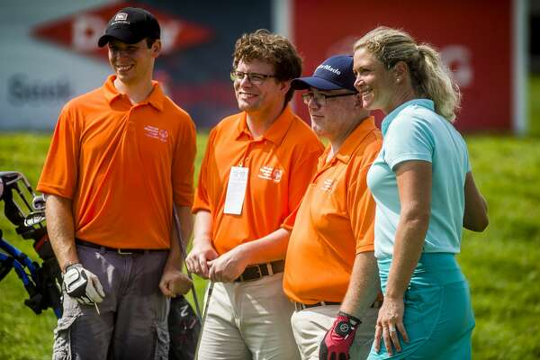 Suzann Pettersen of the LPGA, right, poses for a photo with, from left, Justin Doran, Nick Wagenmaker and Nick McCabe as they compete in the Special Olympics 3-Hole Challenge on Friday, July 19, 2019 at Midland Country Club. (Katy Kildee/kkildee@mdn.net)