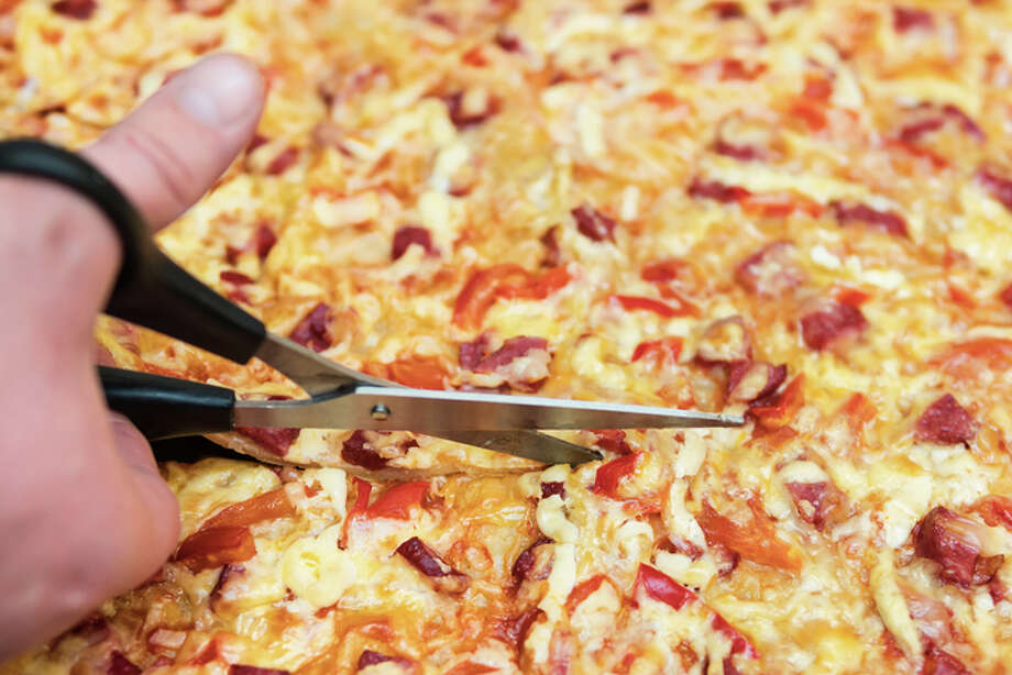 Should you be using scissors to cut pizza? Some chefs say yes. Photo: GrashAlex/Getty Images/iStockphoto