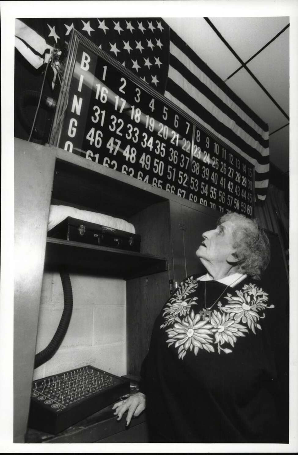 Ancient Order of Hiberians Hall, Quail Street, Albany, New York - Mrs. Bingo, Hilda Gordon, one of the congregation who runs Wednesday night bingo for Ohav Shalom. Hilda is working the number board keeping track of the numbers called. January 19, 1994 (Luanne M. Ferris/Times Union Archive)