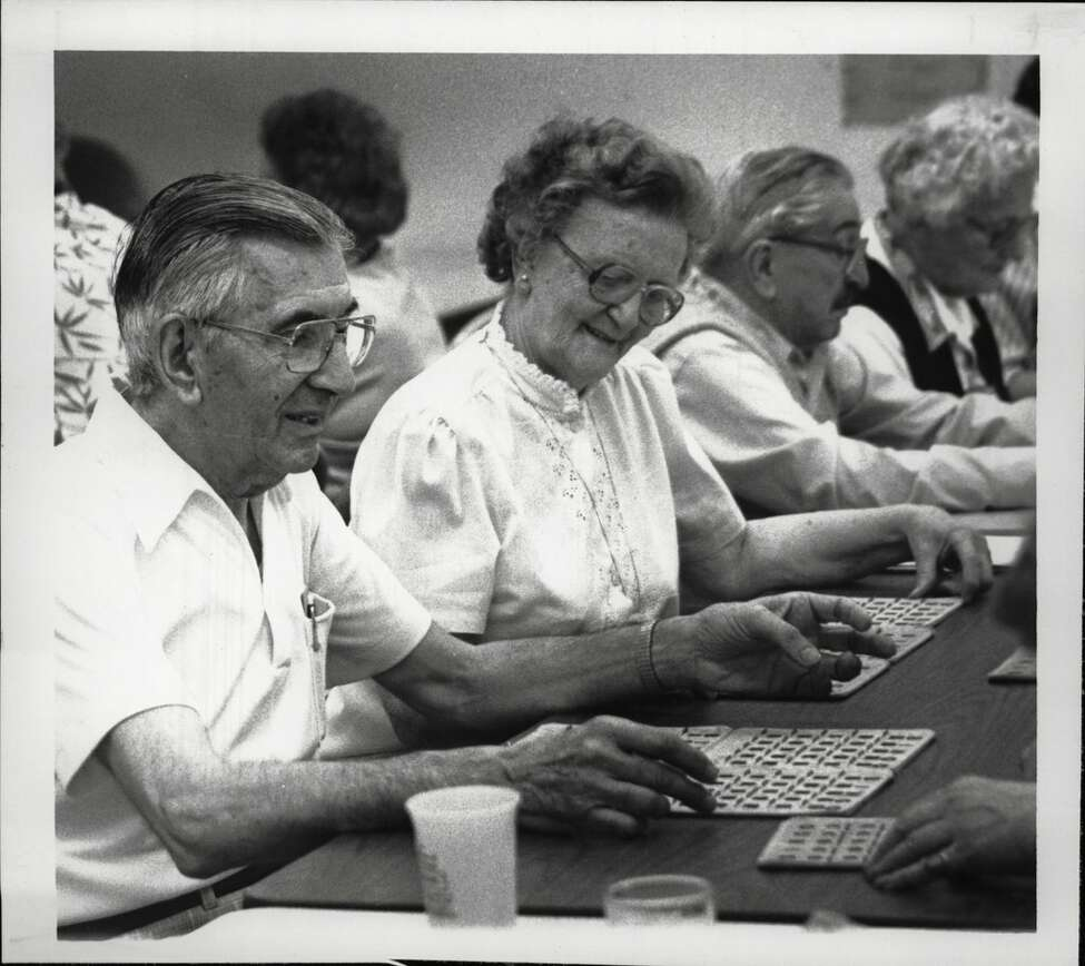 Malta Avenue School, Ballston Spa, New York - Senior Citizens Center - Newton Parente, President of the Senior Citizens Club, and Margaret Irwin on the publicity committee, are among those playing bingo. May 26, 1988 (Paul D. Kniskern, Sr./Times Union Archive)