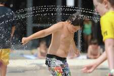 Edward Bergham, 10, of North Salem, N.Y., gets doused with a stream of water at the new Spray Bay at the Ridgefield Parks & Recreation Center in Ridgefield, Conn. Friday, Aug. 8, 2014. The 2,800 sqare foot water playground officially opened Saturday, Aug. 2. The Spray Bay is open Monday through Friday from 10 a.m. to 7 p.m., and Saturday and Sunday from 10 a.m. to 5:45 p.m. It is included with kids Adventure Day Camp and the Family Recreation or Family All-Inclusive memberships with a $10 drop-in rate for non-members.