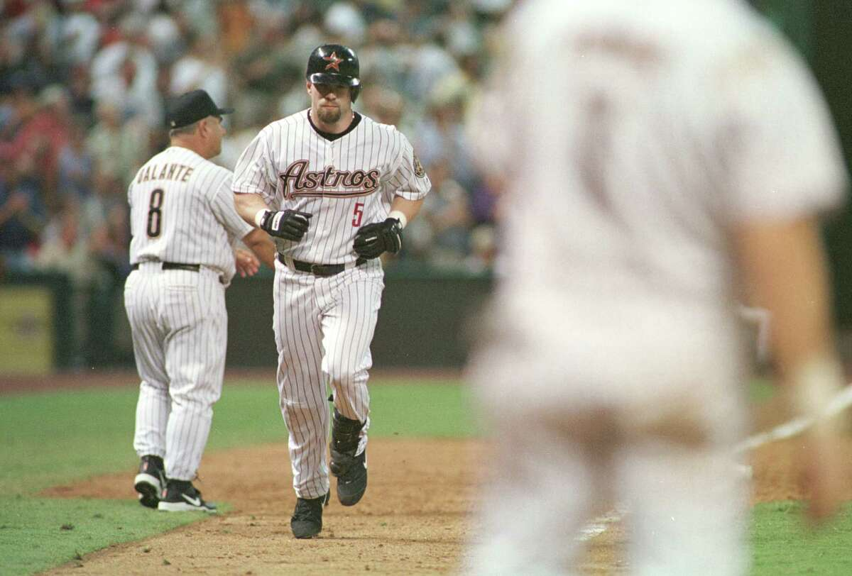 Jeff Bagwell heads for home after hitting a home run during the fifth inning - his second hit of the frame - as he hit for the cycle during the Astros' 17-11 victory over the Cardinals on July 18, 2001 at Minute Maid Park.