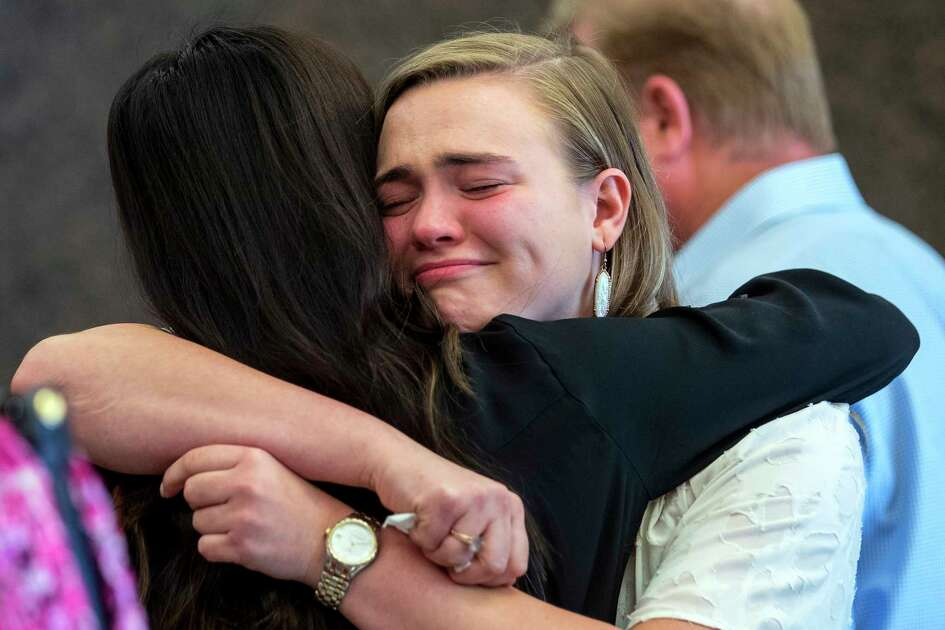 Corina Burnett embraces a supporter outside the courtroom on Friday, July 19, 2019, in Houston, after Marshall Schoen was sentenced in connection to a 2016 drunken driving crash that killed her boyfriend, University of Houston student Mark Tartaglio, as he walked home from a sorority costume party with her. Schoen was sentenced to 10 years in prison, that can be adjusted after 120 days, depending on his behavior in prison. If he's released, he could serve the remainder of his sentence on probation.