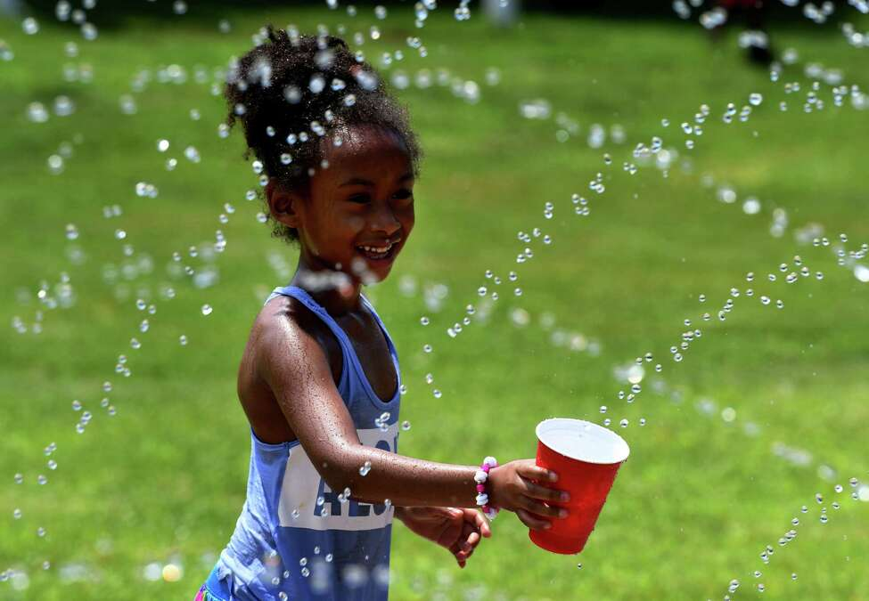 Janeassa Jayden, 6, of Albany cools off in the spray pad at Krank Park on Friday, July 19, 2019, in Albany, N.Y. (Will Waldron/Times Union)