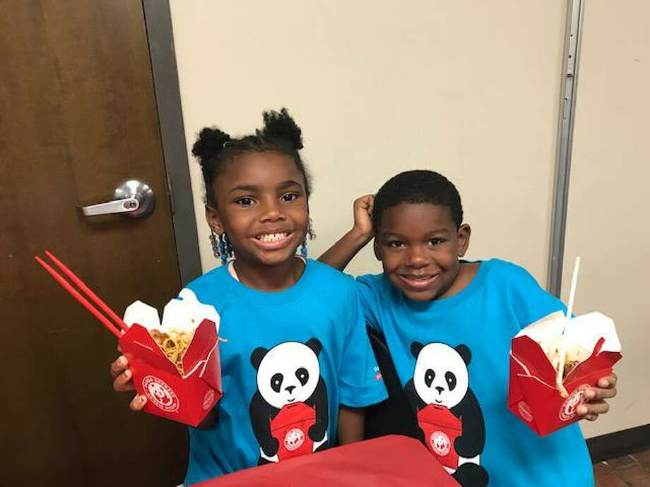Children at the Boys & Girls Club of Greater Houston Kashmere Gardens/North Forest Club enjoy a meal from Panda Express on Thursday, July 18, as the nonprofit Panda Cares presents the clubs with a $20,000 grant to further their academic programs. Photo: Courtesy Photo By Panda Express