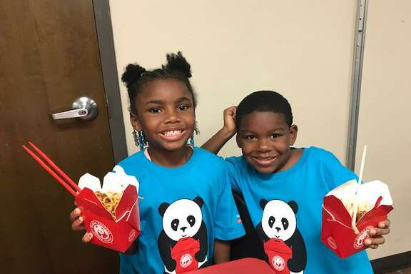 Children at the Boys & Girls Club of Greater Houston Kashmere Gardens/North Forest Club enjoy a meal from Panda Express on Thursday, July 18, as the nonprofit Panda Cares presents the clubs with a $20,000 grant to further their academic programs.