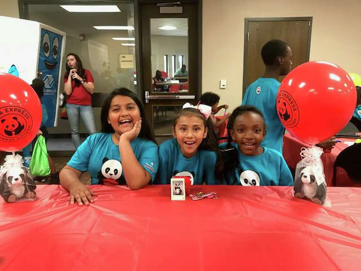 The Boys & Girls Clubs of Greater Houston are currently registering children 6 to 17 years for their after-school programs at 23 area clubs. Here, students have fun and smile for the camera at an event on July 18, which was sponsored by the organization Panda Cares.