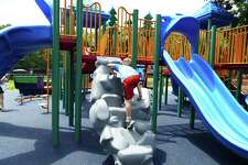 Children have started using the new playground at Mead Park in New Canaan this July 2019. The playground has a Poured in Place, PIP, flooring, which accommodates strollers, kids with specials needs and knees slamming down in a fall.