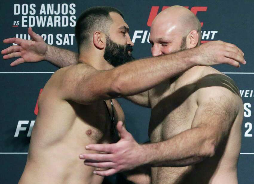 Andrei Arlovski, left, embraces Ben Rothwell after they meet as UFC Fight Night opponents face off after their weigh-in at the Sheraton Gunter Hotel in San Antonio on July 19, 2019.
