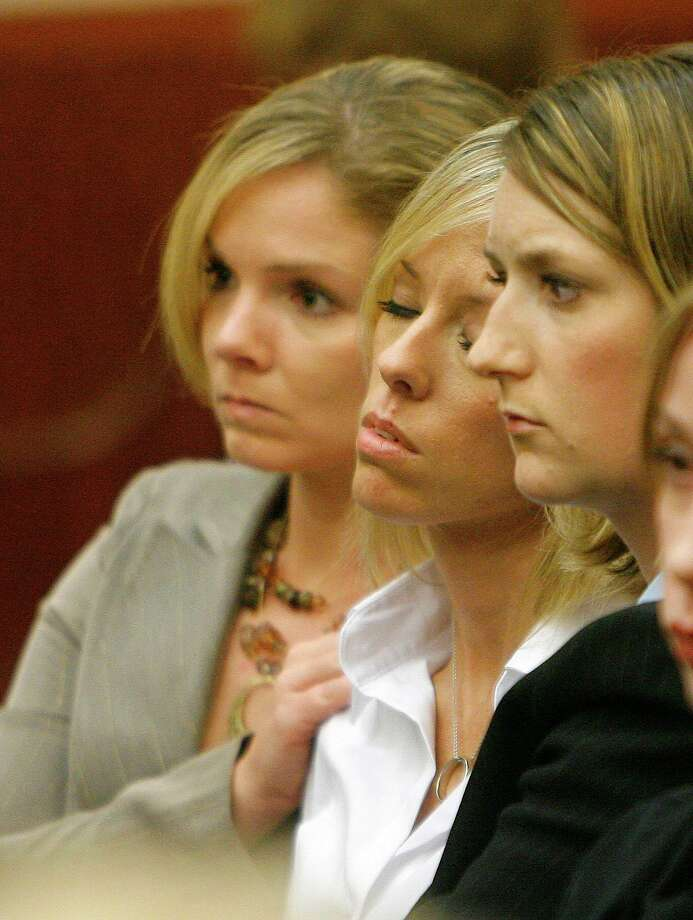 Heather Scott Temple (center, white blouse) is comforted by friends during final arguments in the punishment phase of the trial of her husband, David Temple. Attorneys for the prosecution and defense addressed the jury during closing arguments in the punishment phase of the David Temple trial as it proceeded Monday 11/19/07 in the Criminal Justice Center in Houston, TX. (Monday, Nov. 19, 2007, in Houston. ( Steve Campbell / Chronicle) Photo: Steve Campbell, Staff / Chronicle / Houston Chronicle