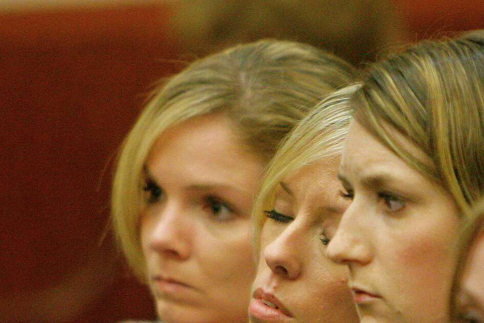 Heather Scott Temple (center, white blouse) is comforted by friends during final arguments in the punishment phase of the trial of her husband, David Temple. Attorneys for the prosecution and defense addressed the jury during closing arguments in the punishment phase of the David Temple trial as it proceeded Monday 11/19/07 in the Criminal Justice Center in Houston, TX. (Monday, Nov. 19, 2007, in Houston. ( Steve Campbell / Chronicle)