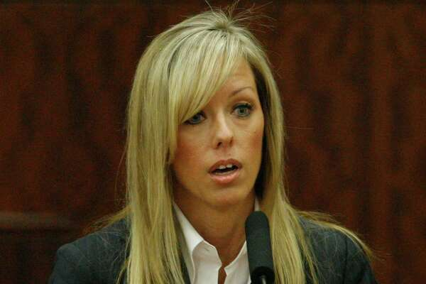 Heather Scott, wife of David Mark Temple, who is charged with murdering his first wife, testifies in his trial Thursday, Oct. 25, 2007, in Houston. His first wife, Belinda Tracie Temple, was killed Jan.11,1999. Temple and Scott married two years later, but were having an affair before Belinda was killed. ( Melissa Phillip / Chronicle )